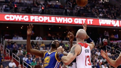 WASHINGTON, DC - FEBRUARY 28: Kevin Durant #35 of the Golden State Warriors and Marcin Gortat #13 of the Washington Wizards go up for the ball in the first half at Verizon Center on February 28, 2017 in Washington, DC. NOTE TO USER: User expressly acknowledges and agrees that, by downloading and or using this photograph, User is consenting to the terms and conditions of the Getty Images License Agreement.  (Photo by Rob Carr/Getty Images)