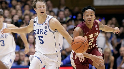 Duke's Luke Kennard (5) and Florida State's CJ Walker (2) chase the ball during the second half of an NCAA college basketball game in Durham, N.C., Tuesday, Feb. 28, 2017. Duke won 75-70. (AP Photo/Gerry Broome)