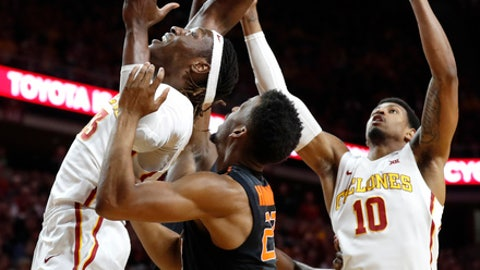 Iowa State forward Solomon Young, left, and forward Darrell Bowie, right, vie for a rebound with Oklahoma State forward Leyton Hammonds, center, during the first half of an NCAA college basketball game, Tuesday, Feb. 28, 2017, in Ames, Iowa. (AP Photo/Charlie Neibergall)