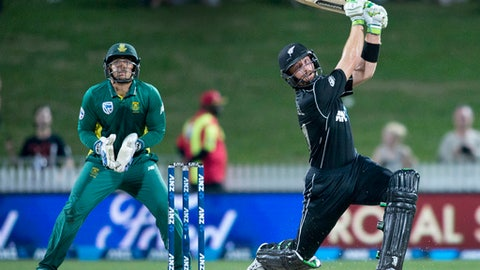 New Zealand batsman Martin Guptill, right, watches as he hits the ball for six runs during their one day cricket international match against South Africa at Seddon Park in Hamilton, New Zealand, Wednesday, March 1, 2017. (Alan Gibson/NZ Herald via AP)
