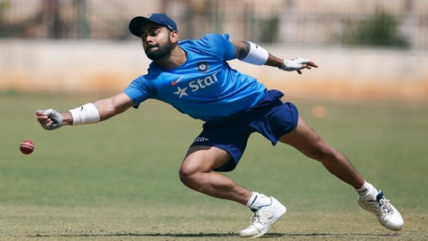 India's captain Virat Kohli stretches to catch the ball during a training session ahead of their second cricket test match against Australia in Bangalore, India, Wednesday, March 1, 2017. (AP Photo/Aijaz Rahi)
