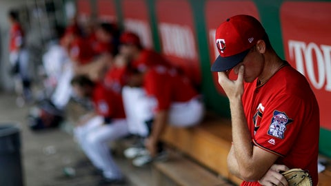 Minnesota Twins pitcher Aaron Slegers stands in the dugout in the sixth inning after giving up a home run in an exhibition spring training baseball game against the Pittsburgh Pirates in Fort Myers, Fla., Wednesday, March 1, 2017. Pittsburgh won 3-1. (AP Photo/David Goldman)