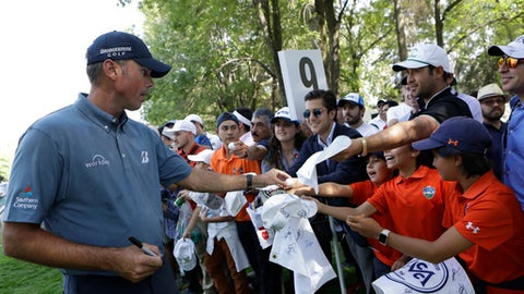 Matt Kuchar of the U.S. signs autographs for fans as he leaves the ninth hole after practicing on the high-altitude course at Chapultepec Golf Club a day before the start of the Mexico Championship, in Mexico City, Wednesday, March 1, 2017. All but one of the world's top 50 golfers will contest the World Golf Championship PGA event, which this year relocated to Mexico City from the Trump National Doral Resort in Florida. (AP Photo/Rebecca Blackwell)
