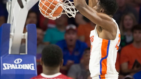 Florida forward Kevarrius Hayes dunks during the first half of the team's NCAA college basketball game against Arkansas in Gainesville, Fla., Wednesday, March 1, 2017. (AP Photo/Ron Irby)