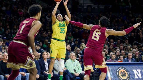 Notre Dame's Bonzie Colson (35) shoots a 3-pointer in front of Boston College's Jerome Robinson (1) and Mo Jeffers (15) during the first half of an NCAA college basketball game Wednesday, March 1, 2017, in South Bend, Ind. (AP Photo/Robert Franklin)