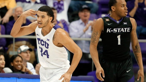 TCU's Kenrich Williams (34) celebrates sinking a three-point basket as Kansas State's Carlbe Ervin II (1) watches in the first half of an NCAA college basketball game, Wednesday, March 1, 2017, in Fort Worth, Texas. (AP Photo/Tony Gutierrez)