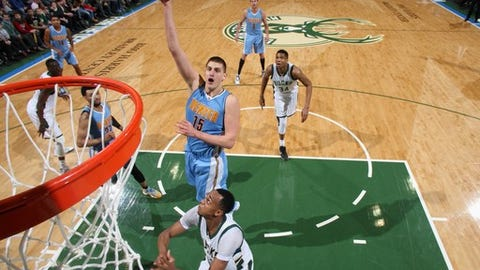 Milwaukee, WI - MARCH 1: Nikola Jokic #15 of the Denver Nuggets shoots the ball against the Milwaukee Bucks on March 1, 2017 at the BMO Harris Bradley Center in Milwaukee, Wisconsin. NOTE TO USER: User expressly acknowledges and agrees that, by downloading and or using this Photograph, user is consenting to the terms and conditions of the Getty Images License Agreement. Mandatory Copyright Notice: Copyright 2017 NBAE (Photo by Gary Dineen/NBAE via Getty Images)