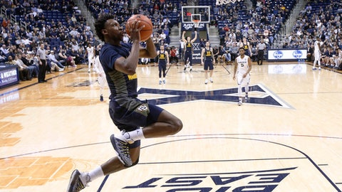 Marquette's Jajuan Johnson goes up to dunk on a breakaway during the second half of the team'sp NCAA college basketball game against Xavier, Wednesday, March 1, 2017, in Cincinnati. Marquette won 95-84. (AP Photo/John Minchillo)