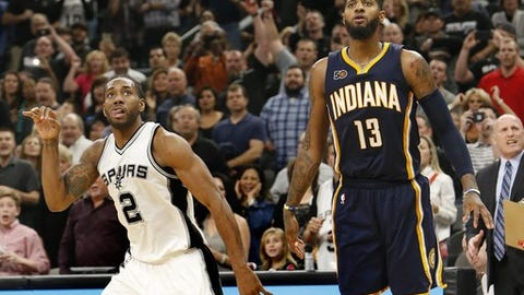 SAN ANTONIO,TX - MARCH 1: Kawhi Leonard #2 of the San Antonio Spurs takes the game winning shot against the Indiana Pacers as Paul George #13 of the Indiana Pacers watches at AT&T Center on March 1, 2017 in San Antonio, Texas.  NOTE TO USER: User expressly acknowledges and agrees that , by downloading and or using this photograph, User is consenting to the terms and conditions of the Getty Images License Agreement. (Photo by Ronald Cortes/Getty Images)
