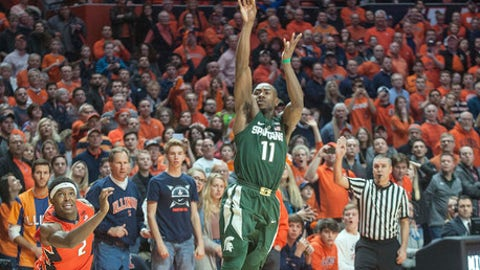 Michigan State guard Lourawls Nairn Jr. (11) puts up a last-second shot between Illinois forward Kipper Nichols (2) and guard Malcolm Hill (21) during the second half of an NCAA college basketball game in Champaign, Ill., Wednesday, March 1, 2017. Illinois won 73-70. (AP Photo/Rick Danzl)