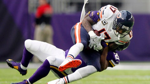 FILE - In this Jan. 1, 2017, file photo, Chicago Bears wide receiver Alshon Jeffery (17) is tackled by Minnesota Vikings cornerback Xavier Rhodes, rear, after making a reception during the second half of an NFL football game in Minneapolis. The draft remains the most significant means by which to build and fortify a franchise. Yet, as the salary cap increases exponentially each year under the 10-year labor agreement reached in 2011, the lure of veterans on the open market can be powerful. (AP Photo/Andy Clayton-King, File)