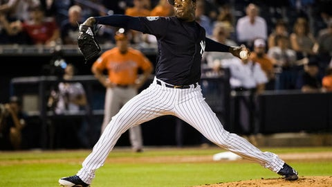 New York Yankees pitcher Aroldis Chapman throws during the fourth inning of a spring training baseball game against the Baltimore Orioles on Thursday, March 2, 2017, in Tampa, Fla. (AP Photo/Matt Rourke)