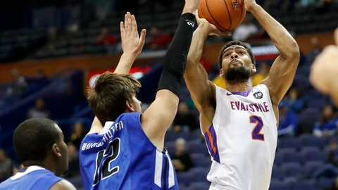 Evansville's Christian Benzon (2) shoots as Indiana State's Niels Bunschoten and T.J. Bell, left, defend during the first half of an NCAA college basketball game in the Missouri Valley Conference tournament Thursday, March 2, 2017, in St. Louis. (AP Photo/Jeff Roberson)