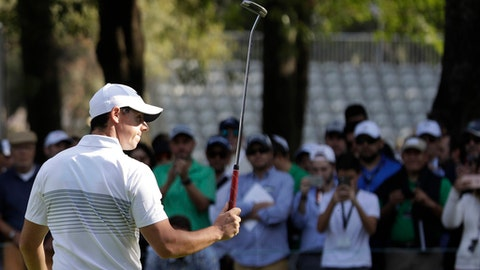 Rory McIlroy of Northern Ireland gestures to fans with his club as he leaves the 9th hole after finishing round one of the Mexico Championship at Chapultepec Golf Club in Mexico City, Thursday, March 2, 2017. All but one of the world's top 50 golfers are contesting the World Golf Championship PGA event, which this year relocated to Mexico City from the Trump National Doral Resort in Florida. (AP Photo/Rebecca Blackwell)