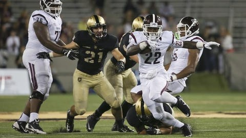 Fordham running back Chase Edmonds (22) runs from Army linebacker Alex Aukerman (21) during the second half of an NCAA college football game Friday, Sept. 4, 2015, in West Point, N.Y. Fordham won 37-35, (AP Photo/Mike Groll)