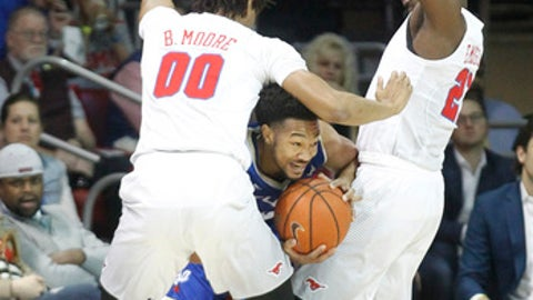 Tulsa guard Corey Henderson Jr. looks for help as he is caught between SMU forward Ben Moore (00) and guard Ben Emelogu II, right, during the first half of an NCAA college basketball game, Thursday, Mar. 2, 2017, in Dallas. (AP Photo/Tim Sharp)