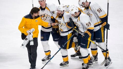Nashville Predators' Ryan Ellis is helped off the ice during the second period of an NHL hockey game against the Montreal Canadiens, Thursday, March 2, 2017 in Montreal.  (Paul Chiasson/The Canadian Press via AP)