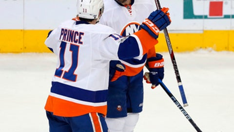 New York Islanders' Shane Prince (11) and Dennis Seidenberg (4) celebrate Seidenberg's goal against the Dallas Stars during the third period of an NHL hockey game, Thursday, March 2, 2017, in Dallas. The Islanders won 5-4. (AP Photo/Tony Gutierrez)