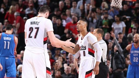 PORTLAND, OR - MARCH 2:  Damian Lillard #0 and Jusef Nurkic #27 of the Portland Trailblazers high five during the game against the Oklahoma City Thunder on March 1, 2017 at the Moda Center in Portland, Oregon. NOTE TO USER: User expressly acknowledges and agrees that, by downloading and or using this Photograph, user is consenting to the terms and conditions of the Getty Images License Agreement. Mandatory Copyright Notice: Copyright 2017 NBAE (Photo by Sam Forencich/NBAE via Getty Images)