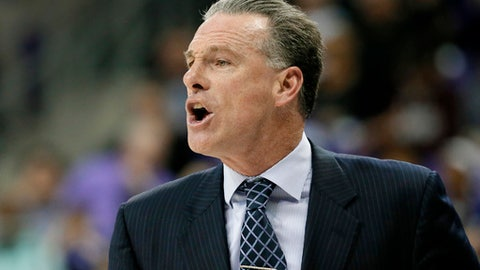 In this March 1, 2017 photo, TCU head coach Jamie Dixon instructs his team during an NCAA college basketball game against Kansas State in Fort Worth, Texas. A week into February, TCU had just pulled out a one-point victory at home and had already won six Big 12 games under new coach Dixon.(AP Photo/Tony Gutierrez)