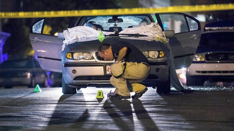 FILE - In this July 16, 2012, file photo, Boston Police investigate a car in which Daniel de Abreu and Safiro Furtado were shot to death near the intersection of Herald Street and Shawmut Avenue in Boston. Former New England Patriots NFL football player Aaron Hernandez is charged with their murders. The jury in his trial is scheduled to visit the crime scene on Friday, March 3, 2017. (AP photo/Courtney Sacco, File)