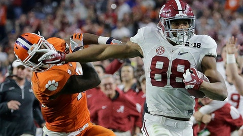 FILE - In this Jan. 11, 2016, file photo, Alabama's O.J. Howard tries to get past Clemson's T.J. Green after a catch during the second half of the NCAA college football playoff championship game, in Glendale, Ariz. The spread offenses in college might produce not-ready-for-prime-time quartrerbacks and tackles. Tight ends are another story. This year's deep class includes Alabama's O.J. Howard and Miami's David Njoku.  (AP Photo/David J. Phillip, File)