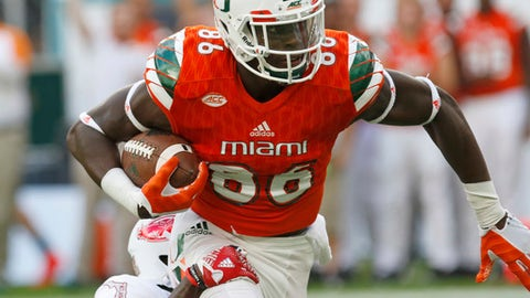 FILE - In this Sept. 10, 2016, file photo, Miami tight end David Njoku (86) is tackled by Florida Atlantic defensive back Raekwon Williams in the first half of an NCAA college football game in Miami Gardens, Fla. The spread offenses in college might produce not-ready-for-prime-time quartrerbacks and tackles. Tight ends are another story. This year's deep class includes Alabama's O.J. Howard and Miami's David Njoku. (AP Photo/Alan Diaz, File)