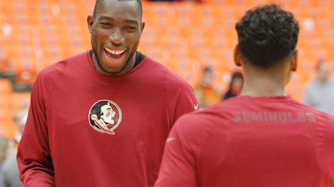 FILE - In this Jan. 28, 2017, file photo, Florida State's Michael Ojo laughs before an NCAA college basketball game against Syracuse in Syracuse, N.Y. Ojo saved his best for his final year at Florida State. The senior is shooting close to 80 percent from the foul line and is a contender for the ACC's Most Improved Player award. (AP Photo/Nick Lisi, File)