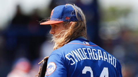 The wind blows New York Mets starting pitcher Noah Syndergaard's hair as he looks in for the sign from New York Mets catcher Rene Rivera in the second inning of a spring training baseball game against the Houston Astros,  Friday, March 3, 2017, in Port St. Lucie, Fla. (AP Photo/John Bazemore)