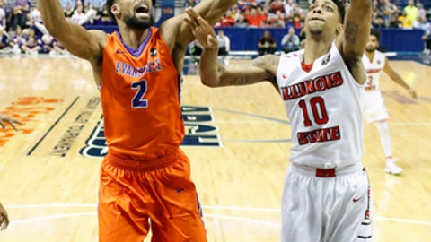 Illinois State's Phil Fayne (10) is unable to score as Evansville's Christian Benzon (2) defends during the second half of an NCAA college basketball game in the quarterfinals of the Missouri Valley Conference men's tournament Friday, March 3, 2017, in St. Louis. Illinois State won 80-69. (AP Photo/Jeff Roberson)