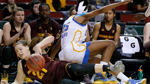 UCLA forward Monique Billings comes down on Arizona State forward Sophie Brunner, left, as they scrambled for a loose ball during the first half of an NCAA college basketball game in the Pac-12 tournament, Friday, March 3, 2017, in Seattle. (AP Photo/Ted S. Warren)