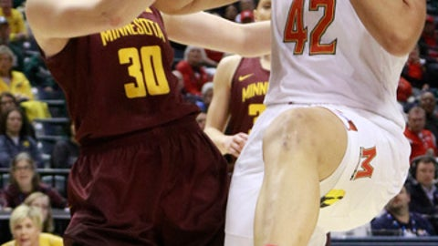 Maryland center Brionna Jones (42) and Minnesota forward Whitney Tinjum (30) fight for control of the basketball during the first half of an NCAA college basketball game in the quarterfinals of the Big 10 conference tournament, Friday, March 3, 2017, in Indianapolis. (AP Photo/R Brent Smith)