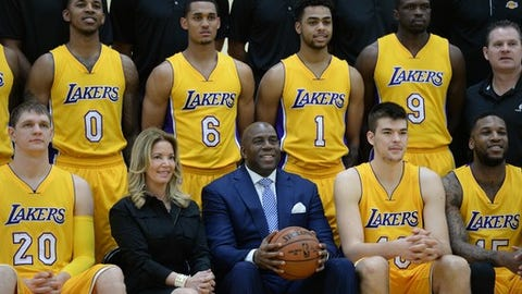 EL SEGUNDO, CA - FEBRUARY 27:  Magic Johnson and Jeannie Buss of the Los Angeles Lakers pose during the 2016-2017 Los Angeles Lakers team photo onFebruary 27, 2017 at the The Toyota Sports Center in El Segundo, California. NOTE TO USER: User expressly acknowledges and agrees that, by downloading and or using this photograph, User is consenting to the terms and conditions of the Getty Images License Agreement. Mandatory Copyright Notice: Copyright 2016 NBAE (Photo by Juan O'Campo/NBAE via Getty Images)