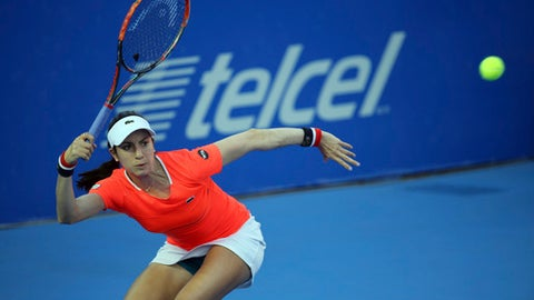 Christina Mchale, from the U.S., returns to France's Kristina Mladenovic during a semifinal match of the Mexican Tennis Open in Acapulco, Mexico, Friday March 3, 2017. (AP Photo/Enric Marti)