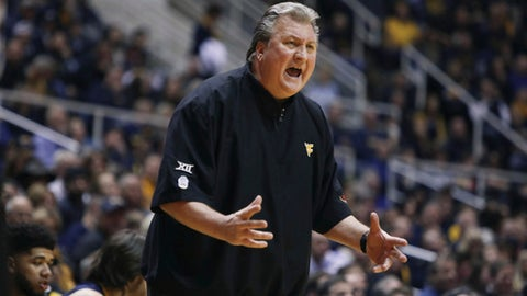 West Virginia coach Bob Huggins yells to his players during the first half of an NCAA college basketball game against Iowa State, Friday, March 3, 2017, in Morgantown, W.Va. (AP Photo/Raymond Thompson)