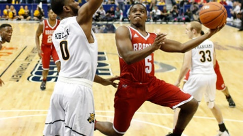 Bradley's Darrell Brown (5) shoots over Wichita State's Rashard Kelly (0) during the second half of an NCAA college basketball game in the quarterfinals of the Missouri Valley Conference men's tournament Friday, March 3, 2017, in St. Louis. (AP Photo/Jeff Roberson)
