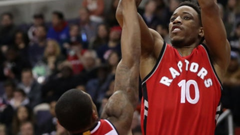 WASHINGTON, DC - MARCH 03:  DeMar DeRozan #10 of the Toronto Raptors puts up a shot over Bradley Beal #3 of the Washington Wizards in the first half at Verizon Center on March 3, 2017 in Washington, DC. NOTE TO USER: User expressly acknowledges and agrees that, by downloading and or using this photograph, User is consenting to the terms and conditions of the Getty Images License Agreement.  (Photo by Rob Carr/Getty Images)
