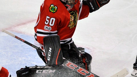 Chicago Blackhawks goalie Corey Crawford makes a save during the second period of an NHL hockey game against the New York Islanders, Friday, March 3, 2017, in Chicago. (AP Photo/Paul Beaty)