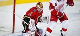 Backlund scores in OT, Flames salvage win over Red Wings