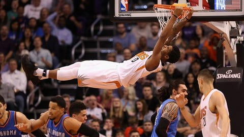 PHOENIX, AZ - MARCH 03:  Marquese Chriss #0 of the Phoenix Suns slam dunks the ball against the Oklahoma City Thunder during the first half of the NBA game at Talking Stick Resort Arena on March 3, 2017 in Phoenix, Arizona. NOTE TO USER: User expressly acknowledges and agrees that, by downloading and or using this photograph, User is consenting to the terms and conditions of the Getty Images License Agreement.  (Photo by Christian Petersen/Getty Images)