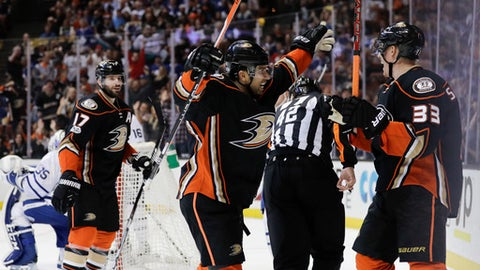 Anaheim Ducks' Jakob Silfverberg, right, celebrates his goal with Andrew Cogliano during the second period of an NHL hockey game against the Toronto Maple Leafs, Friday, March 3, 2017, in Anaheim, Calif. (AP Photo/Jae C. Hong)