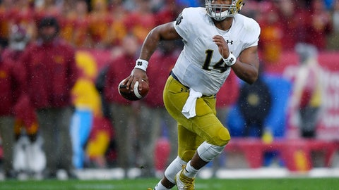 FILE - In this Nov. 26, 2016, file photo, Notre Dame quarterback DeShone Kizer runs the ball during the team's NCAA college football game against Southern California in Los Angeles. Kizer finds himself in good company at the NFL combine in what is generally described as an unusually uninspiring crop of quarterbacks. None of the prospects are currently in the discussion to go No. 1 overall. It's unclear whether any will even go in the top 10. And all of the prospects in town appear to have something to prove. After Kizer led his injury-plagued team into playoff contention in 2015, his first season as the starter, the Fighting Irish went 4-8 in his second season. Suddenly, the prototypically sized, strong-armed Kizer was being viewed as a flawed player with significant questions. (AP Photo/Mark J. Terrill, File)