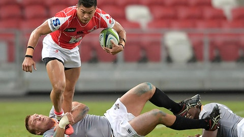 Japan's Shota Emi of the Sunwolves runs with the ball while South Africa's Ross Geldenhuys of the Southern Kings tackles him during their Super Rugby match on Saturday, March 4, 2017, in Singapore. (AP Photo/Joseph Nair)