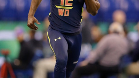 Washington wide receiver John Ross runs the 40-yard dash in 4.22 seconds to set a new record at the NFL football scouting combine in Indianapolis, Saturday, March 4, 2017. (AP Photo/Michael Conroy)