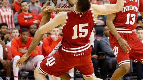 Ohio State's Trevor Thompson, left, is fouled by Indiana's Zach McRoberts during the second half of an NCAA college basketball game Saturday, March 4, 2017, in Columbus, Ohio. Indiana beat Ohio State 96-92. (AP Photo/Jay LaPrete)