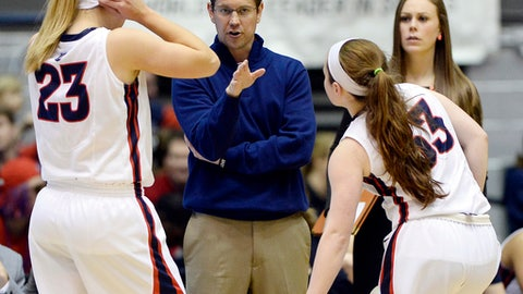 Belmont head coach Cameron Newbauer talks with Kylee Smith (23) and Darby Maggard (33) during the first half of an NCAA college basketball game against Eastern Kentucky in the championship of the Ohio Valley Conference basketball tournament Saturday, March 4, 2017, in Nashville, Tenn. (AP Photo/Mark Zaleski)