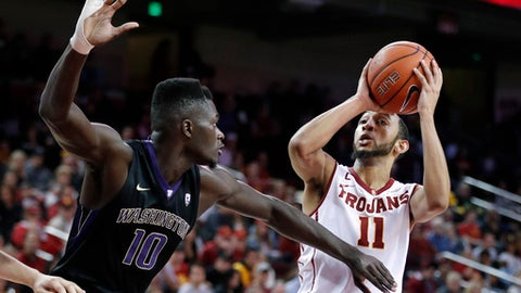 Southern California's Jordan McLaughlin, right, shoots as Washington's Malik Dime defends during the second half of an NCAA college basketball game, Saturday, March 4, 2017, in Los Angeles. (AP Photo/Jae C. Hong)