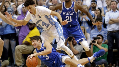 North Carolina's Justin Jackson (44) guards against Duke's Grayson Allen (3) as Duke's Amile Jefferson (21) watches at rear during the first half of an NCAA college basketball game in Chapel Hill, N.C., Saturday, March 4, 2017. (AP Photo/Gerry Broome)