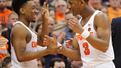 Syracuse's John Gillon, left, and Syracuse's Andrew White III, right, celebrate as White leaves the game in the final minutes of an NCAA college basketball game against Georgia Tech in Syracuse, N.Y., Saturday, March 4, 2017. (AP Photo/Nick Lisi)