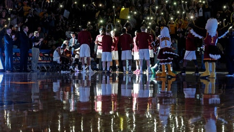 Winthrop players are introduced before the Big South Conference championship NCAA college basketball game against Campbell in Rock Hill, S.C., Sunday, March 5, 2017. . (AP Photo/Chuck Burton)